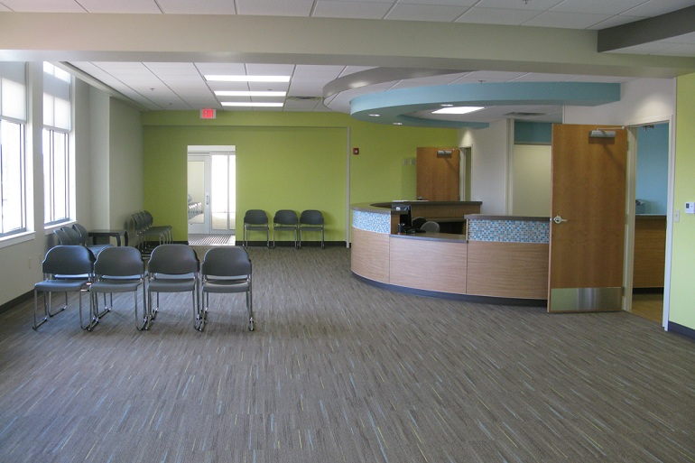 Image of a hospital reception being cleaned